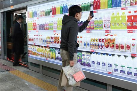virtual supermarket shopper scanning QR codes